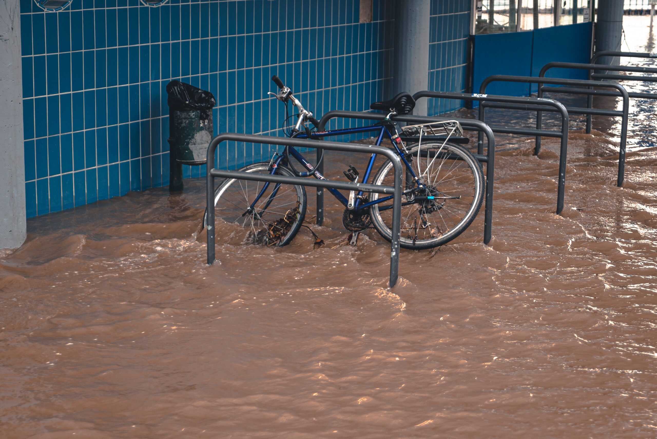water damage in street with partially submerged bicycle