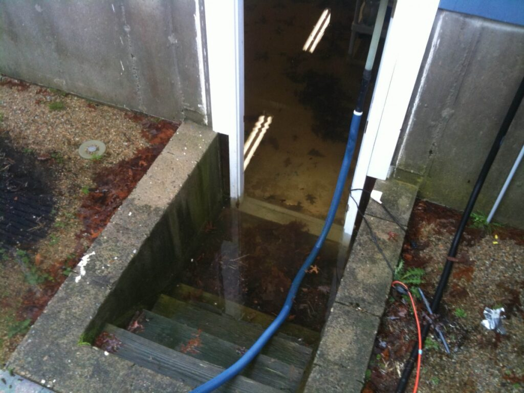 water damage in basement as seen from cement staircase