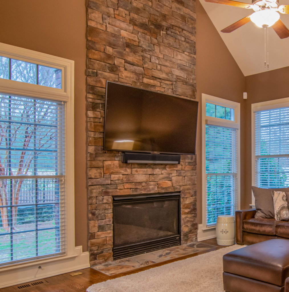 floor to ceiling stone fireplace remodel