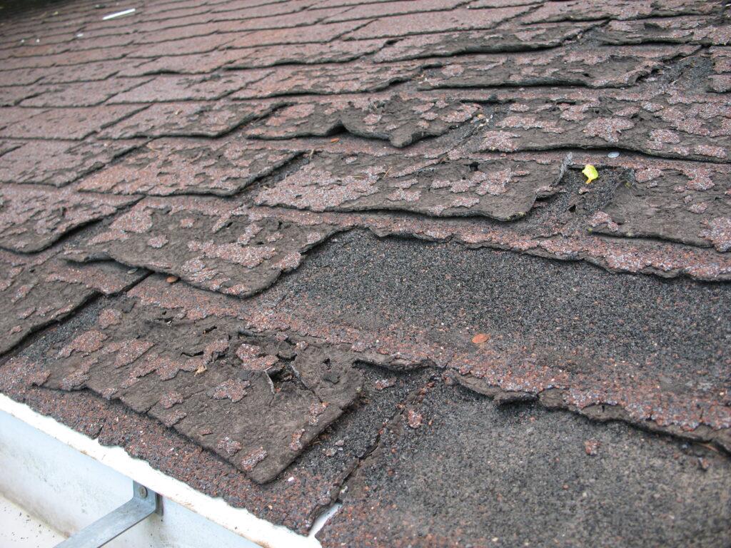 decayed asphalt shingles