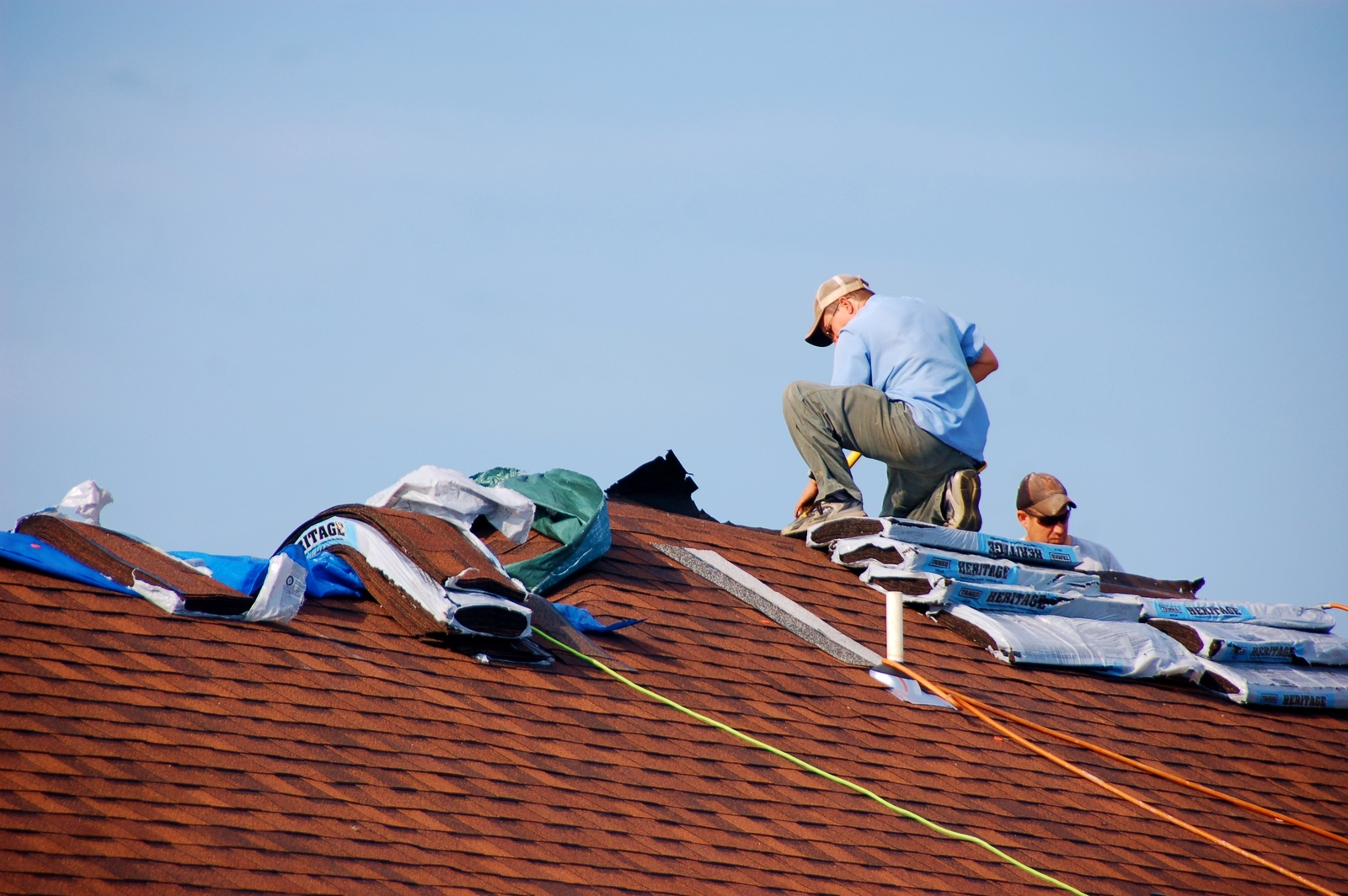 roofing contractors working on damaged roof