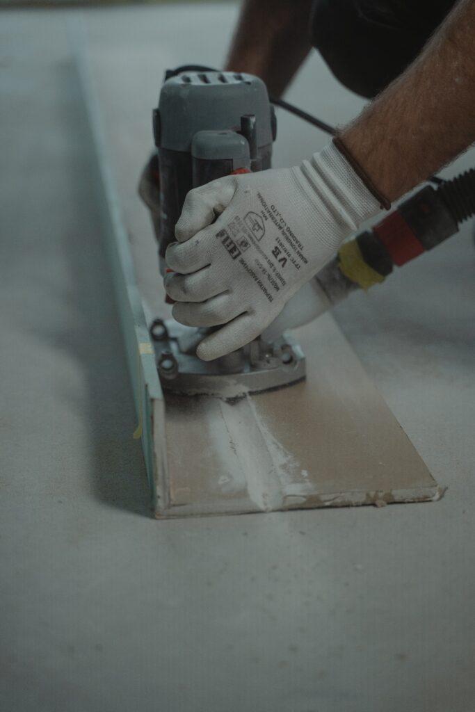 contractor sanding counter