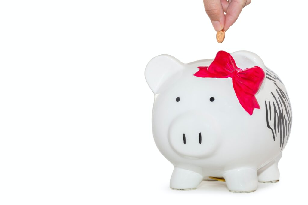 piggy bank with coin being dropped in