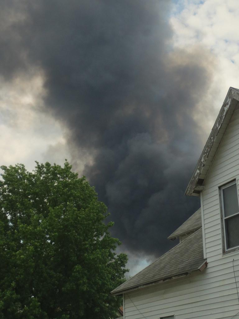 dark smoke over residential home