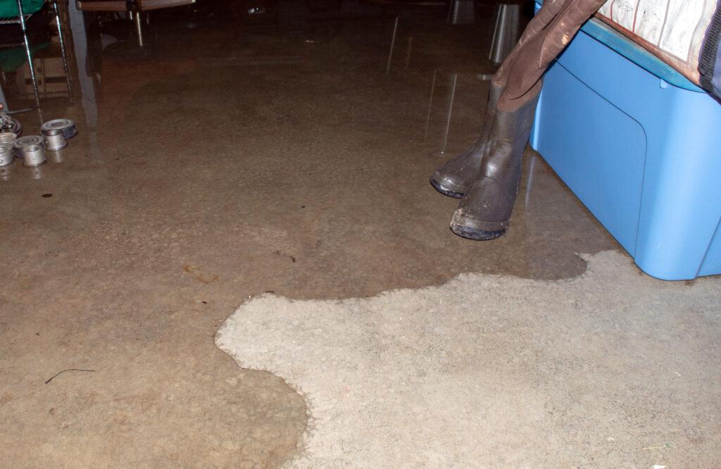 flood water creeping on cement floor