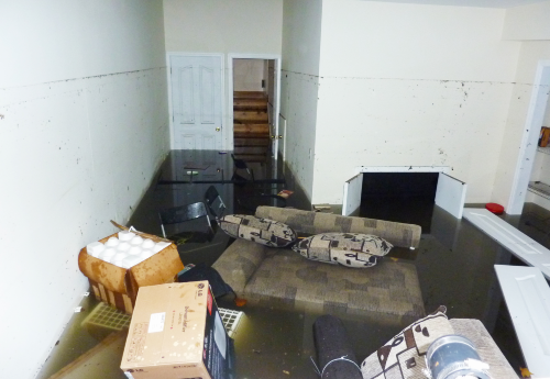 image of flooded basement with submerged furniture